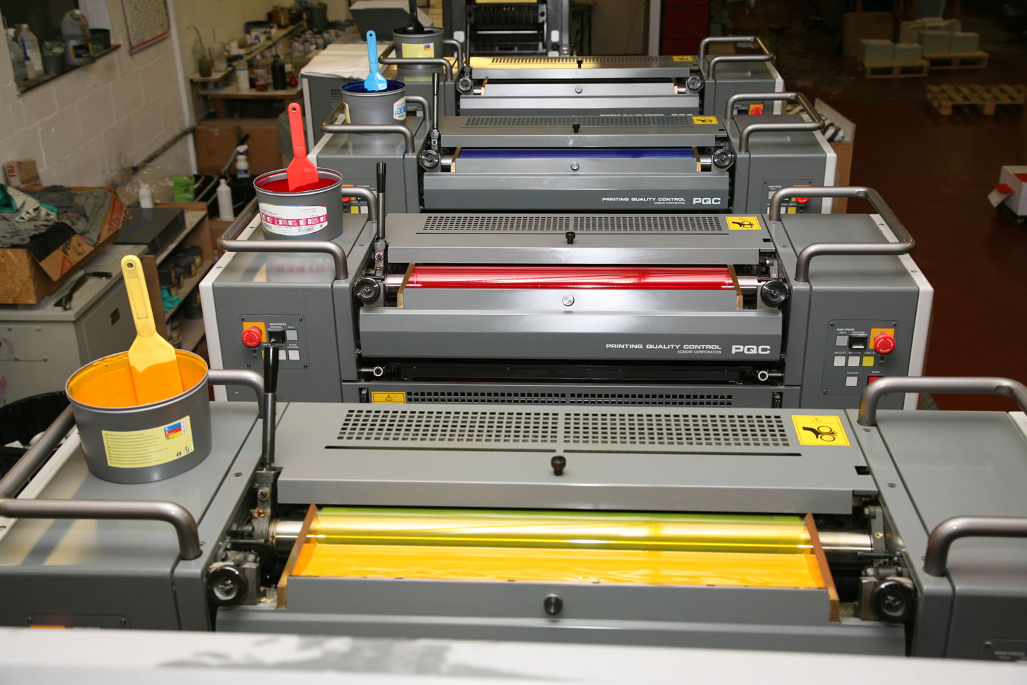 working litho press showing 4 colour stations